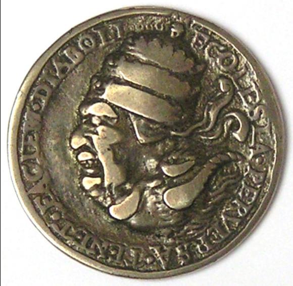 Cette médaille anti-catholique circule en Allemagne et en France à partir de 1545. Elle représente le pape entouré de l'inscription latine « L'Église perverse a le visage du diable ». En latin, le mot perversa invite aussi à retourner la médaille à 180 degrés pour découvrir l'autre visage du pape.