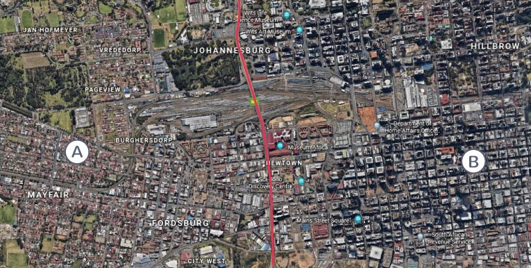 Les quartiers riches et le bidonville de la ville de Johannesburg
